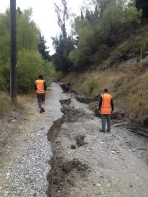 Council staff inspecting a section of the Glenda Dr trail in March after heavy rain. Photos supplied