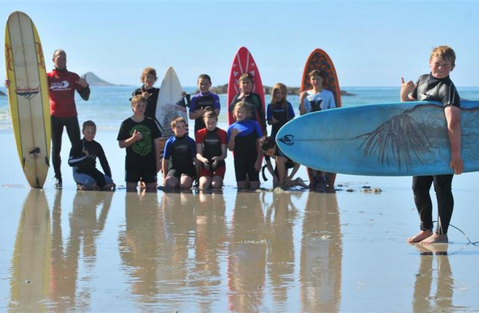 Pictured with Cameron Johnston (front) are surf instructor Steve Newton and pupils (standing from...