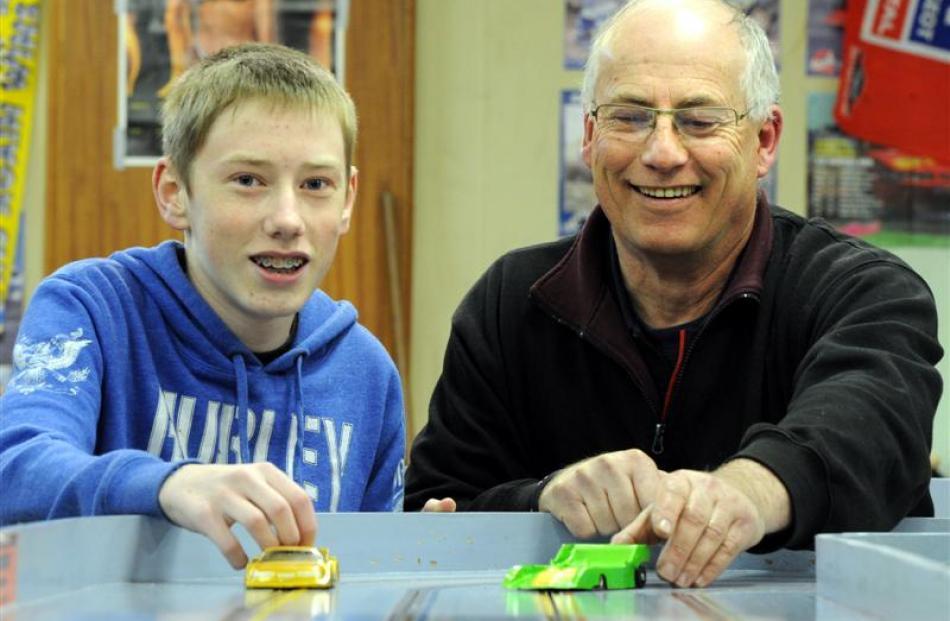 Pitlane Slot Car Club members  Jack Watson (14), of Abbotsford, and Graeme Saxton (58), of...
