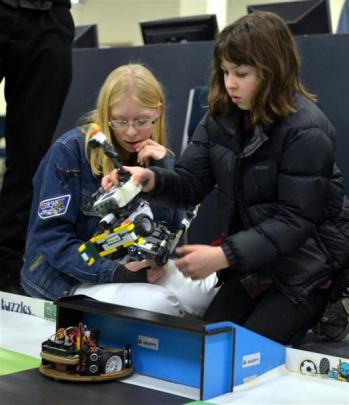 Placing robots on the soccer pitch  Caitlin Shaw (left) and Heather Robertson, both 13, watch...