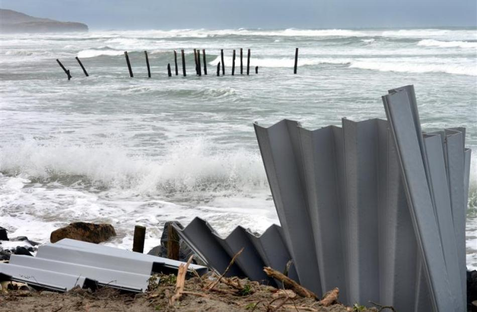 Plastic sheet piling put in place last week has already been bent and broken by the waves at St...