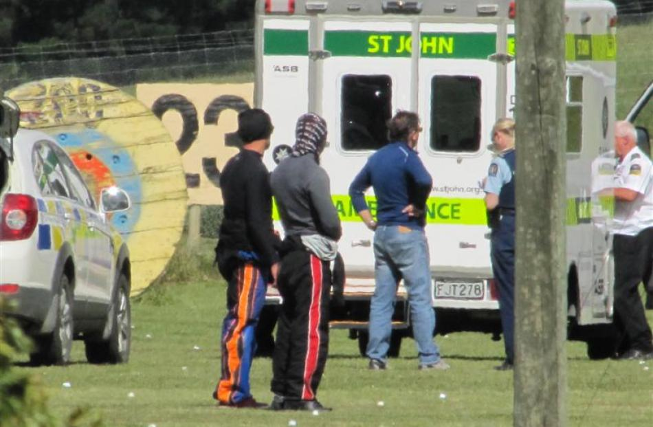 Police and ambulance staff at the scene of a skydiving fatality near Wanaka Airport yesterday...