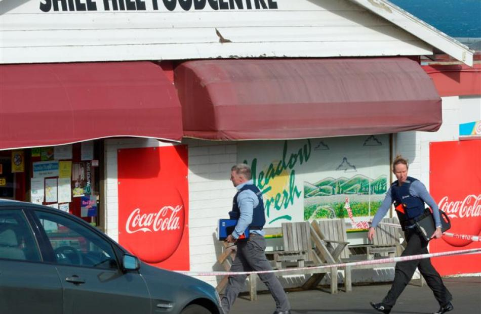 Police at the scene of an armed robbery at the Shiel Hill Foodcentre yesterday afternoon. Photo...
