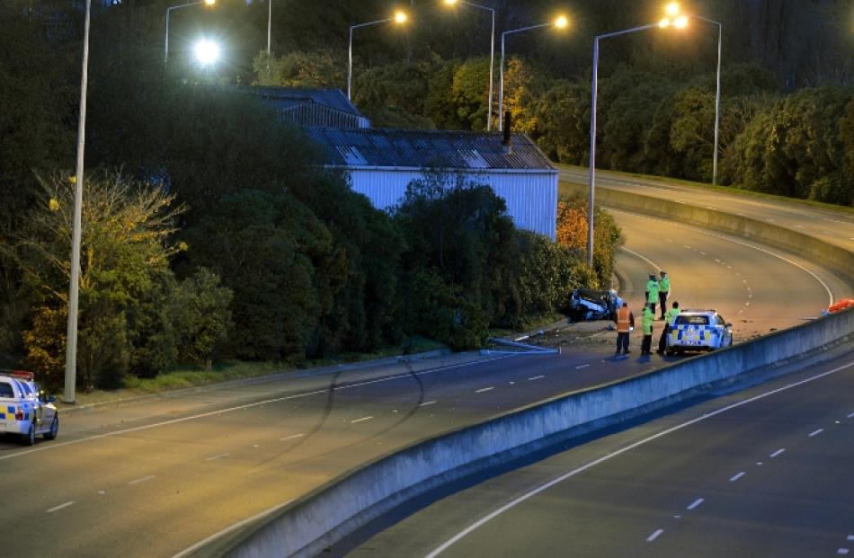 Police at the scene of this morning's fatal crash on Dunedin's Southern Motorway. Photo by...