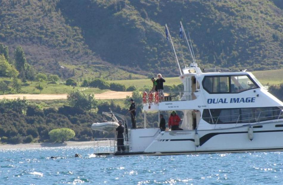Police divers search Lake Wanaka yesterday evening for the body of Trevor Hawke. Photo by Lucy...