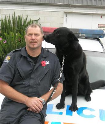 Police dog handler Peter Hanlin and Zero on their last day at work. Photo by Stephen Jaquiery.