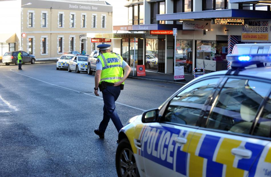 Police secure the scene after a pedestrian was seriously injured in Moray Pl, Dunedin. Photo by...