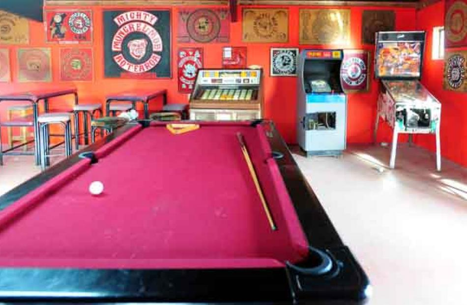The well-equipped clubroom, with various Mongrel Mob insignia emblazoned on the wall
