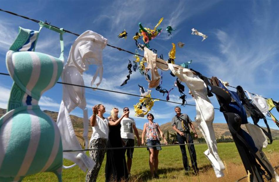 Preparing to add dozens of  bras from overseas  to the revived Cardrona Valley bra fence on...