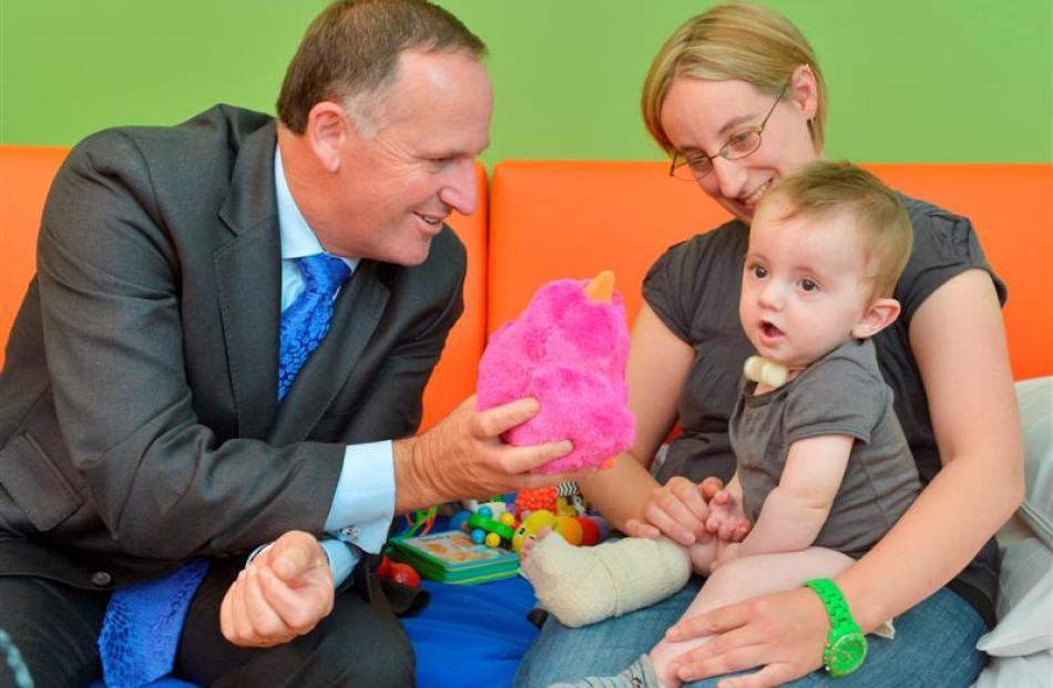 Prime Minister John Key entertains Brendan Forbes, who was in Dunedin Hospital's new paediatric...