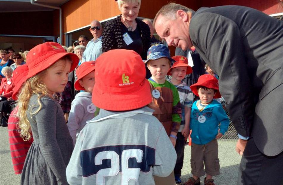 Prime Minister John Key is greeted at the opening of Dunedin Kindergartens' Forbury Rd site by...