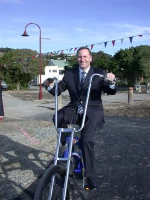 Prime Minister John key takes a chopper for a spin on the new harbourside walk and cycleway in...