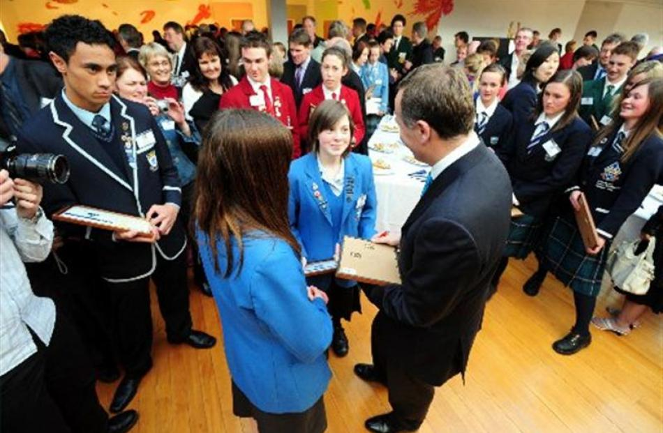 Prime minister John Key talks to Queens High School pupils at the Class Act 2009 award ceremony....