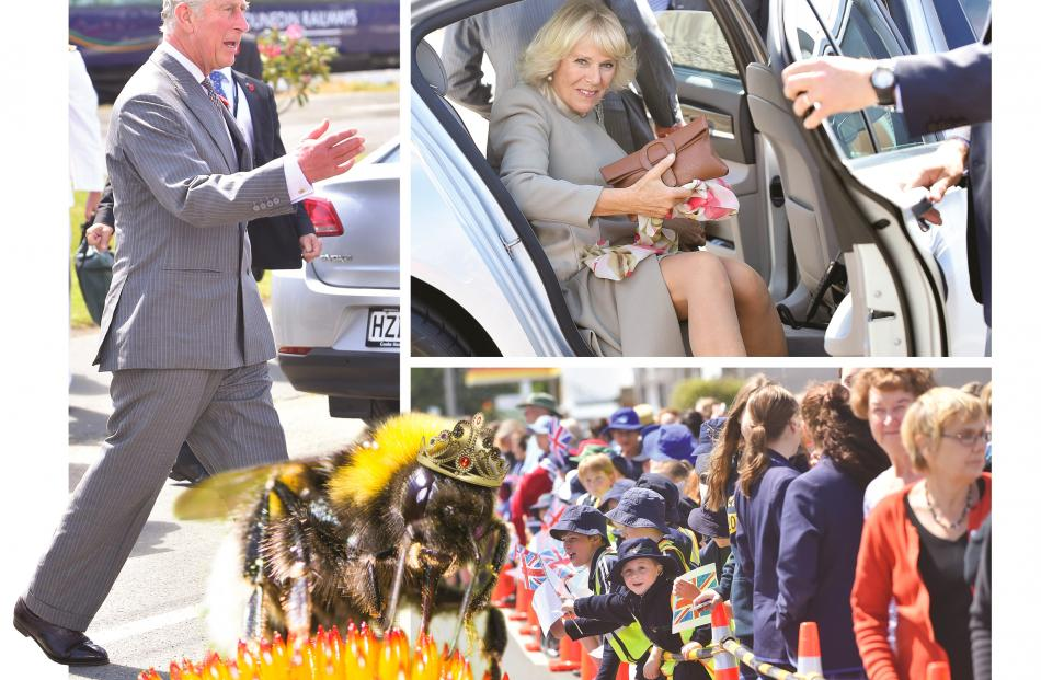 Prince Charles and Camilla, the Duchess of Cornwall, are greeted at Mosgiel on Thursday. The...