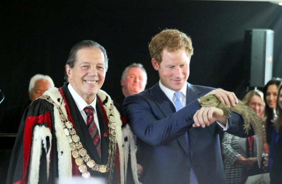 Prince Harry holds Henry the tuatara, from the Southland Museum and Art Gallery. Photo by Allison...