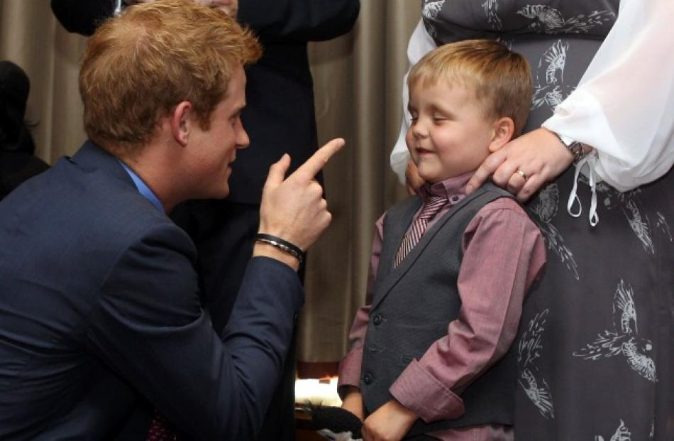 Prince Harry talks to 6-year-old Alex Logan as he attends the WellChild awards ceremony at the...