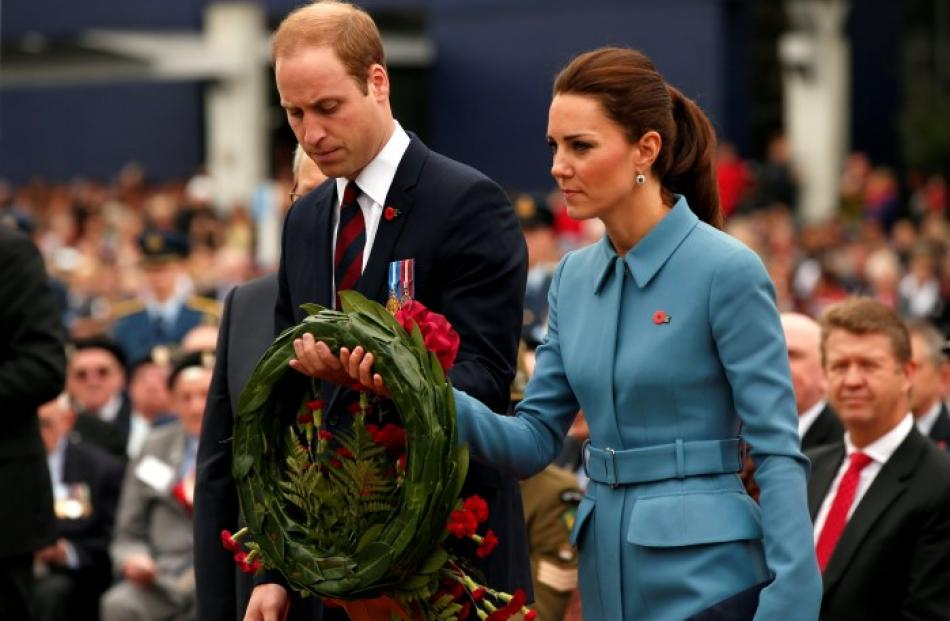 Prince William and his wife Catherine, Duchess of Cambridge, prepare to lay a wreath at the war...