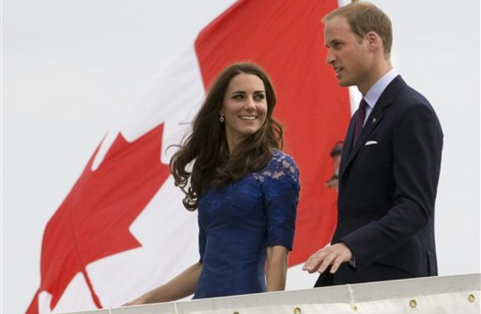 Prince William and Kate, the Duke and Duchess of Cambridge, leave the HMCS Montreal as they...