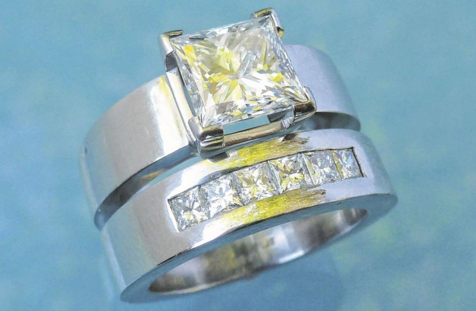 Princess cut diamond set in platinum by Chris Idour.