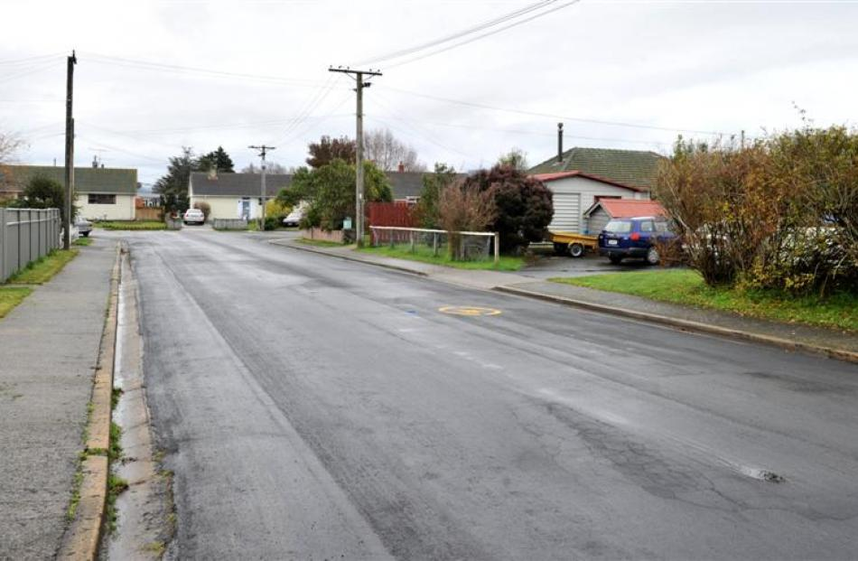 Problems with cracking in the road surface of  Dunbar Pl, Mosgiel, after roadworks. Photos by...