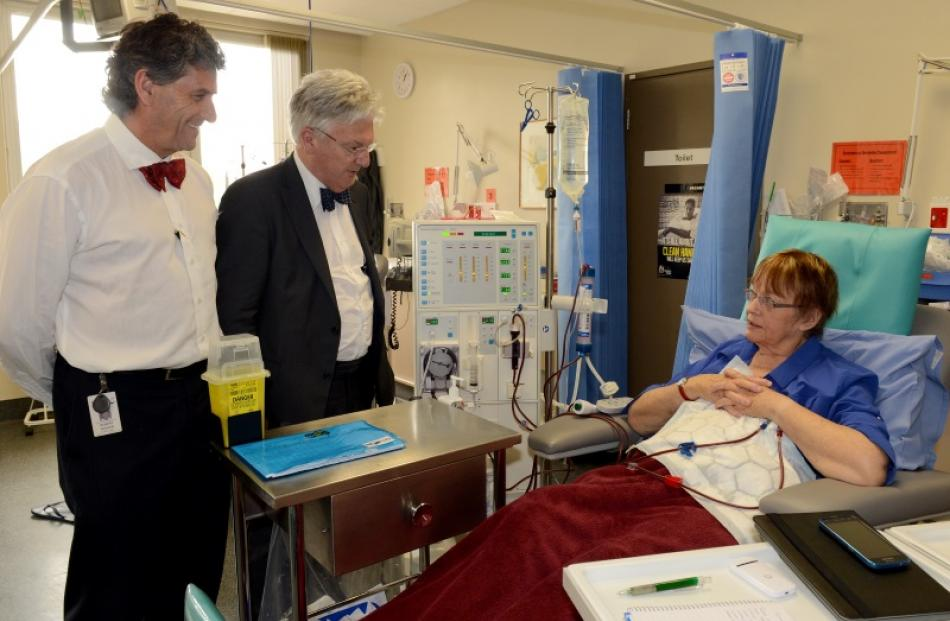 Prof Rob Walker (left) and Associate Health Minister Peter Dunne talk to dialysis patient Betty...