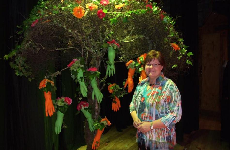 "Professional florist and floral art designer Francine Thomas, of Tauranga, with her design ""Hands..."