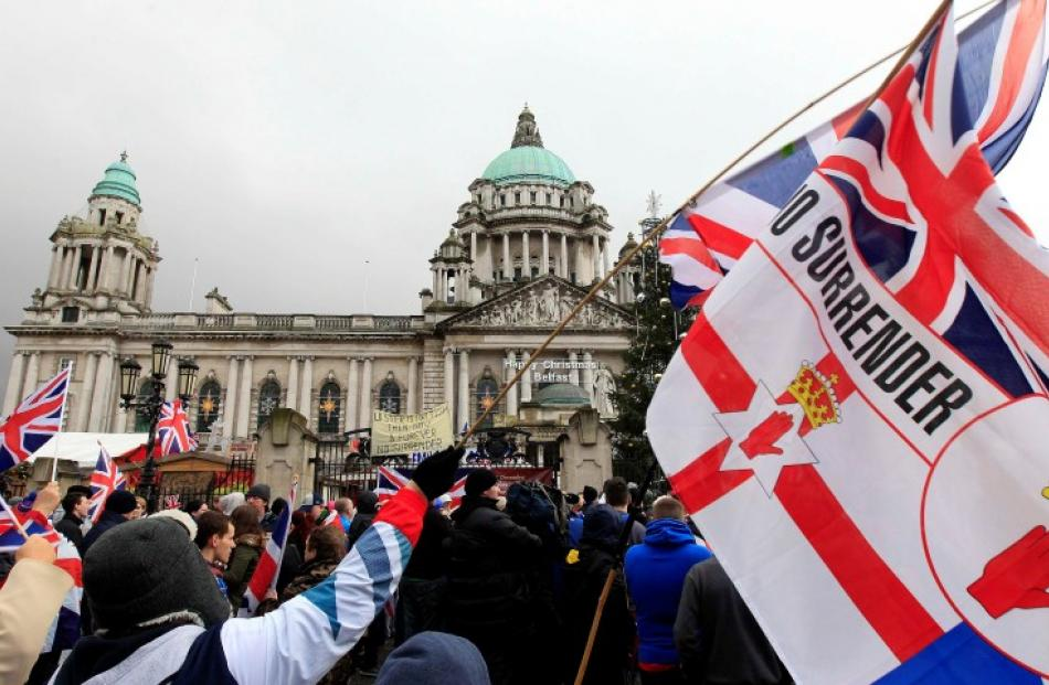 Protesters rally in front of Belfast's City Hall demanding the British flag be returned to the...