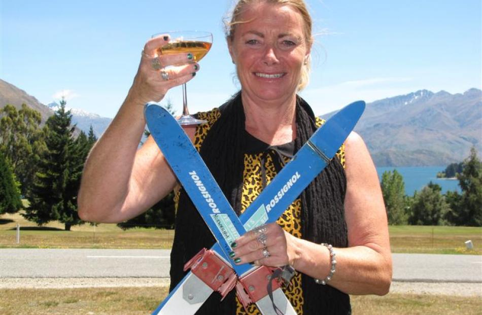 Proud mum Stacey Wells, of Wanaka, with the tiny skis her sons learned  on as toddlers. Sons ...