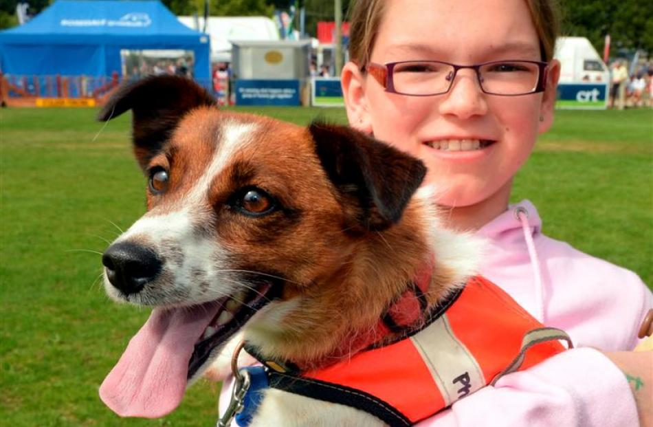 Proud owner Hannah Hutton (10) holds race-winner Kate.