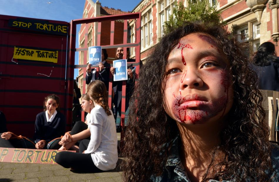 Otago Girls' High School pupil Veronique Montalba (13) wears special effects make›up to protest...