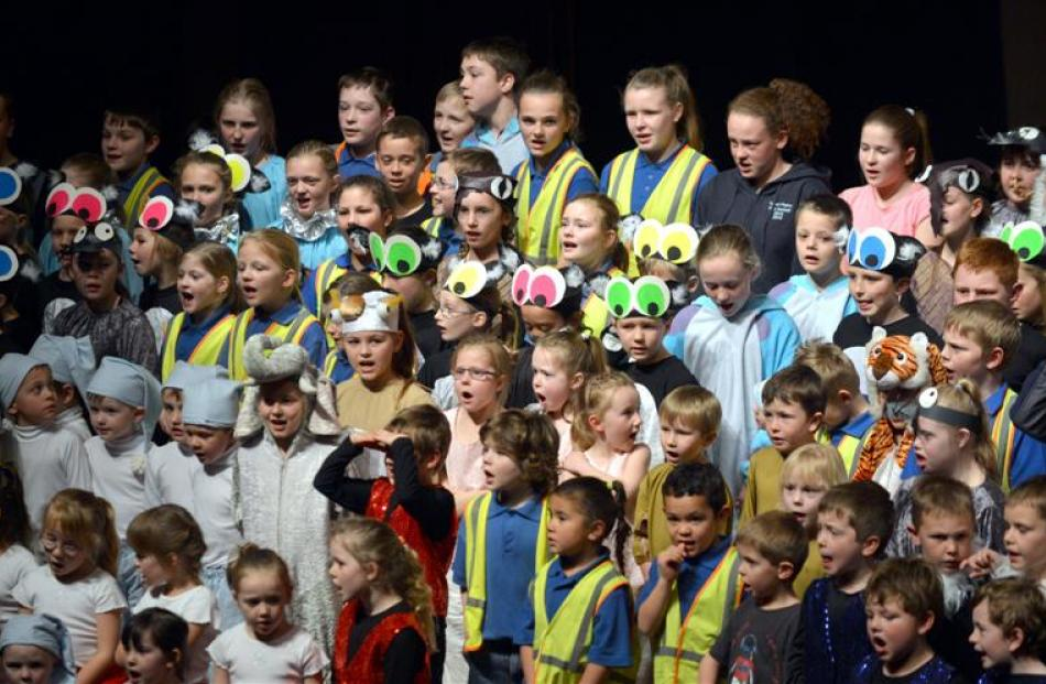 Pupils sing The Lion Sleeps Tonight .