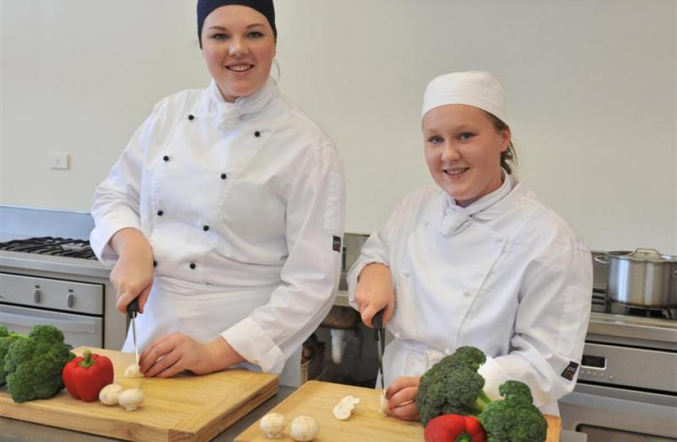 Queen's High School culinary arts pupils Lauren Wright (left) and Abby Johnson practise their...