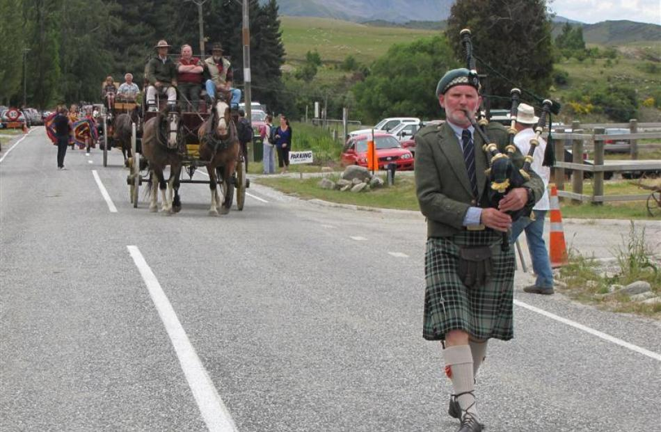 Queenstown bagpiper Graeme Glass (above)  leads the procession through the main street of Cardrona.