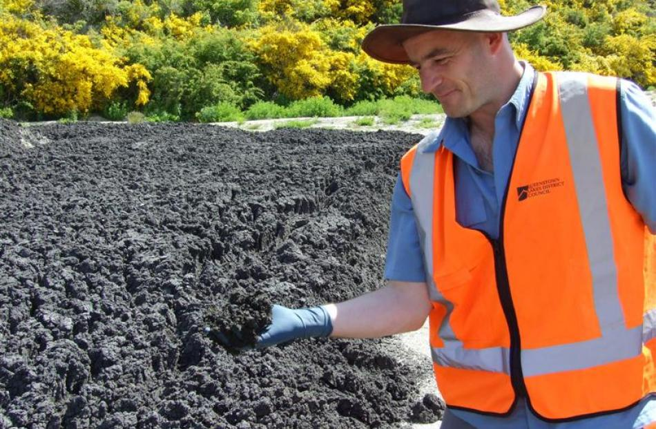 Queenstown Lakes District Council strategic project manager Martin O'Malley  checks drying sludge...