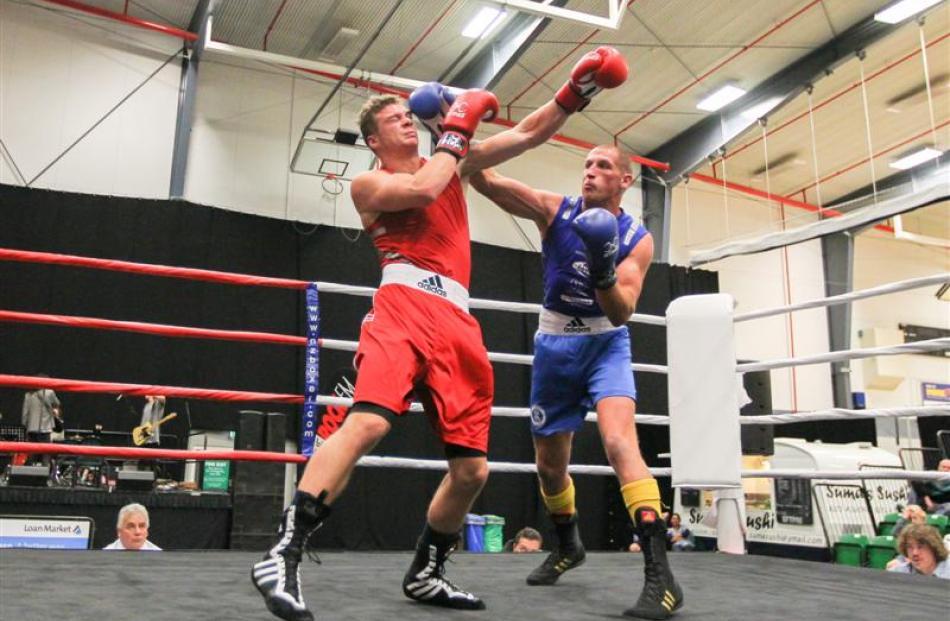 Queenstown light heavyweight Sam Connely (blue)  beats Sam Beck, of Dunedin. Photos by Blair...
