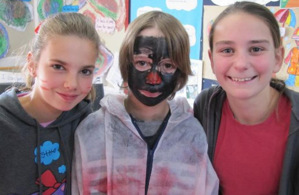 Queenstown Primary School pupils (from left to right) Ella Gibson (year 6), Luke Peter (year 7,...