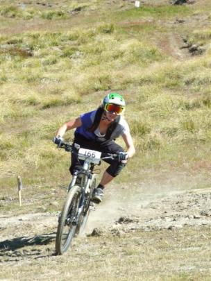 Queenstown's Harriet Latchem rides to the checkpoint marking the end of the first stage. Photos...