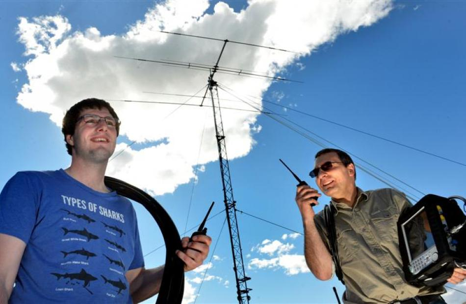 Radio technicians (from left) Adam Campbell, of Balclutha, and Stewart Hall, of Dunedin, complete...