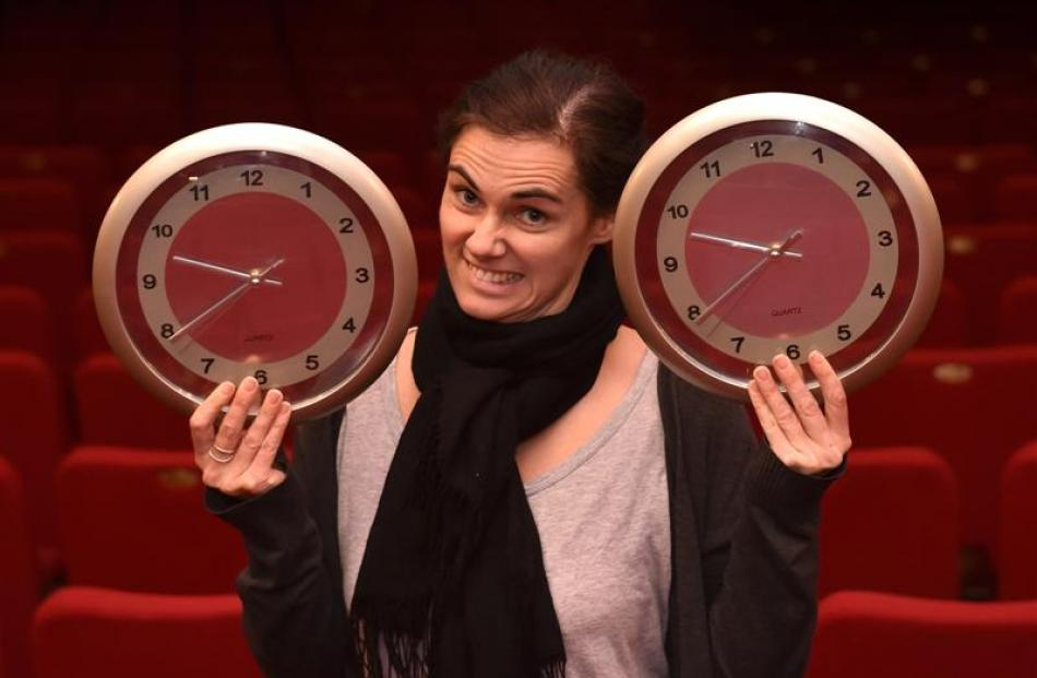 Regent Theatre marketing manager Hannah Molloy holds two clocks that stopped at the same time...