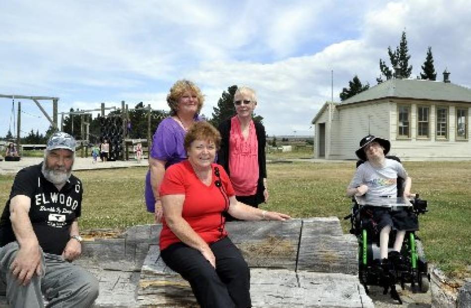 Relaxing at Camp Sutton  on Friday are (from left) Dunedin  holidaymakers John Fitzwilliam,...