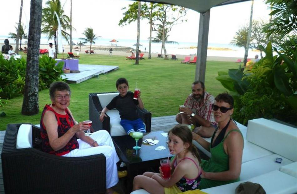 Relaxing at Club Med Bali are (from left) wife Dianne, grandchildren Tamai (8), Billie (10), son...