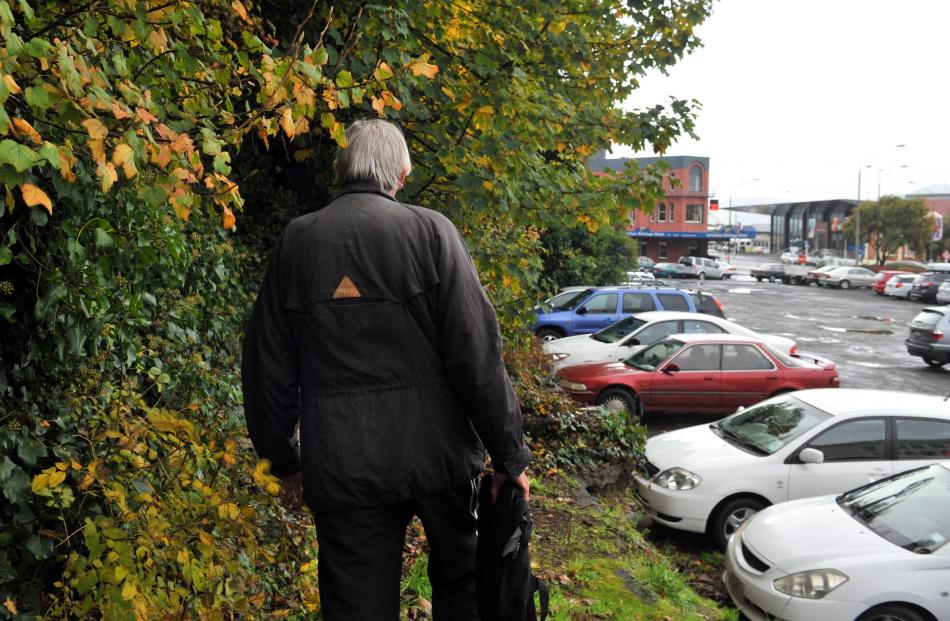 Rex (not his real name) heads for bushes below First Church where he slept rough for several...