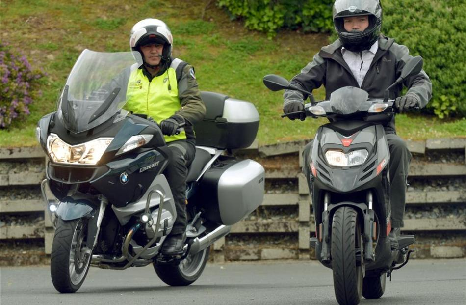 Ride Forever instructor Pete Daly, of Christchurch, teaches reporter Shawn McAvinue on the urban...