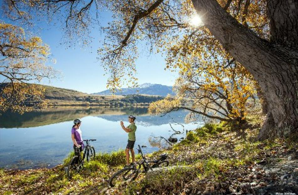 Riders pause for a photo during an autumn ride on the Lake Hayes Circuit. Photo by Miles Holden.