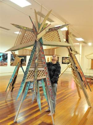 Riverton artist Chris Flavell with his Maori kite sculptures at the Dunedin Community Gallery....