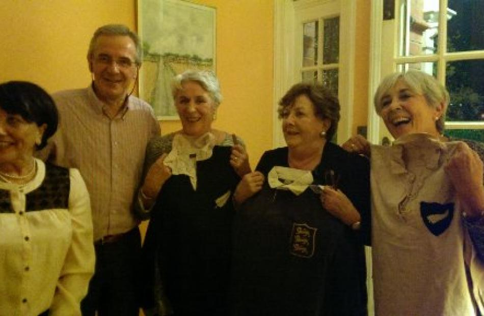 Robyn Opie (left) after returning the Lions jersey to Michael Dunne's adult children, Peter Dunne...