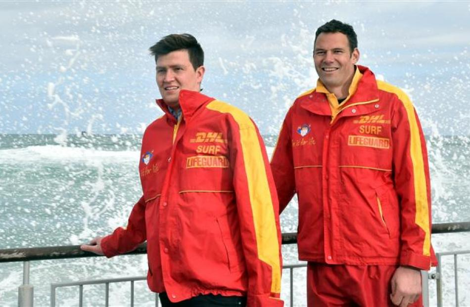 St Clair Surf Life Saving Club members Sam Clutterbuck (left) and Brent Matehaere stand above the...