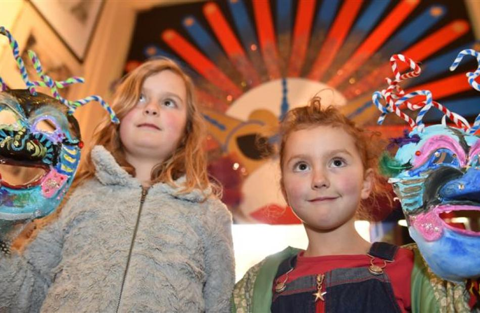 Romahapa sisters Cassie (7, left) and Joss (6)  Winslade  show off their masks at last night's...