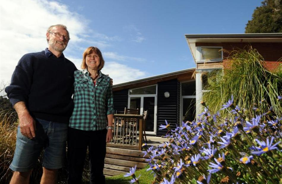 Roy and Jan Johnstone in their terraced garden. Photo by Peter McIntosh.