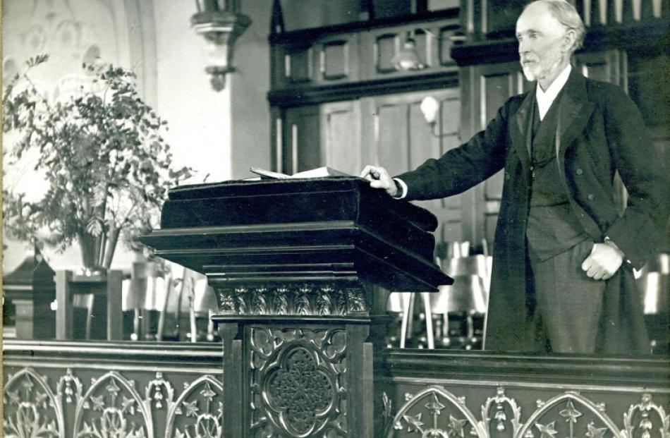 Rutherford Waddell stands at the pulpit of St Andrew's Presbyterian Church, Walker St, Dunedin,...